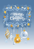 Christmas greeting card with frozen spruce branches and different christmas decorations. Calligraphic lettering Merry Christmas on blue background. Vector illustration.