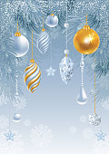 Christmas greeting card with frozen spruce branches and different christmas decorations.  Vector illustration.