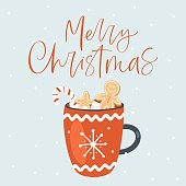 Merry Christmas greeting card with cup of cocoa.