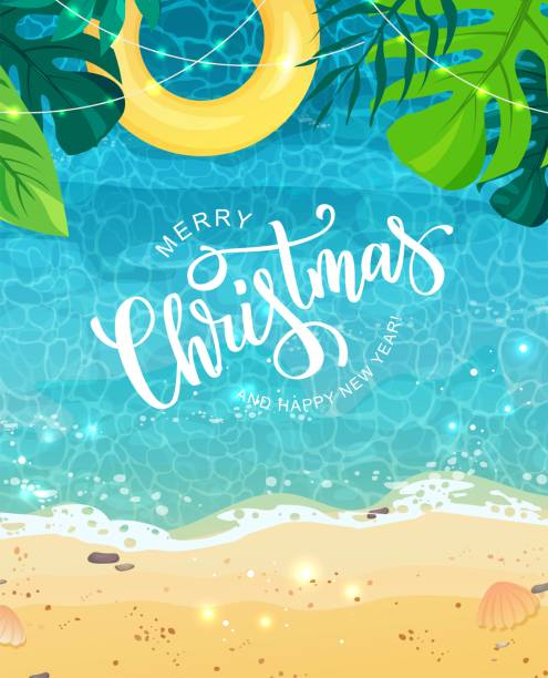 Merry Christmas hand lettering text for exotic New Year celebration. Summer seashore with sand and yellow swim ring, tropical leaves, top view. The wave rolls onto the sand, sea foam, blue water. Vector australian christmas stock illustrations