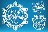 Merry Christmas laser cut lettering template. Calligraphic inscription inside a snowflake and a Christmas ball, cutting template, Xmas holiday decoration, vector.