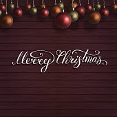 istock Merry Christmas lettering with red,orange,gold christmas balls on wooden wall. New Year composition . Vector illustration 1280301046