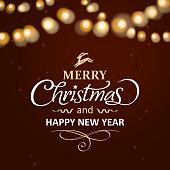 Merry christmas calligraphy in front of light effect background.