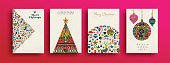 Merry Christmas holiday folk art card collection. Template set of scandinavian style xmas tree and traditional geometric shapes in festive colors. EPS10 vector.