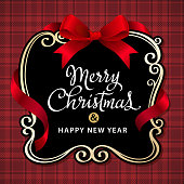 Christmas place card with red ribbon on the tartan cloth pattern