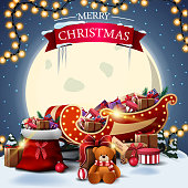 istock Merry Christmas, square postcard with winter landscape, big yellow moon, Santa Claus bag and Santa Sleigh with presents 1266265722