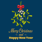 Merry Christmas with hanging mistletoe. Christmas lettering with decorative design elements. Greeting card