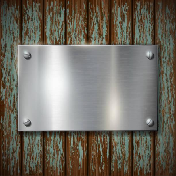 metallplättchen auf eine hölzerne mauer - nagelplatte stock-grafiken, -clipart, -cartoons und -symbole