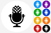 Microphone Icon on Flat Color Circle Buttons. This 100% royalty free vector illustration features the main icon pictured in black inside a white circle. The alternative color options in blue, green, yellow, red, purple, indigo, orange and black are on the right of the icon and are arranged in two vertical columns.