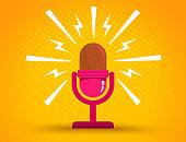istock Microphone on yellow halftone background 1213204799