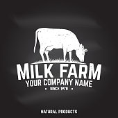 Milk Farm Badge or Label on the chalkboard. Vector illustration. Vintage typography design with cow silhouette. Elements on the theme of the milk farming business.
