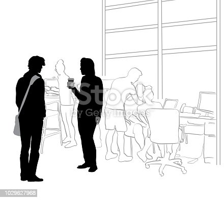 Young man and woman talking in a busy office