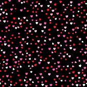 Vector seamless pattern of little red, pink and white hearts on a black background.