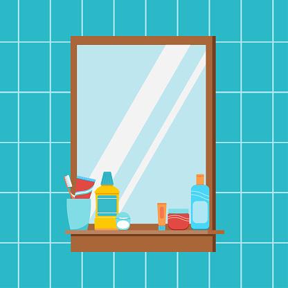 Mirror in bathroom with hygiene accessories on shelf.