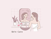 Beauty Girl Standing in front of  Mirror in Bathroom. Woman Take Care of her Face and Body Skin. Spa Procedures at Home. Skin Care Routine and Hygiene Concept. Flat Cartoon Vector Illustration.