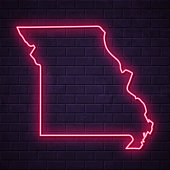 Map of Missouri in a realistic neon sign style. The map is created with a pink glowing neon light on a dark brick wall. Modern and trendy illustration with beautiful bright colors. Vector Illustration (EPS10, well layered and grouped). Easy to edit, manipulate, resize or colorize.