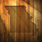 Missouri Map on lit Wooden Background