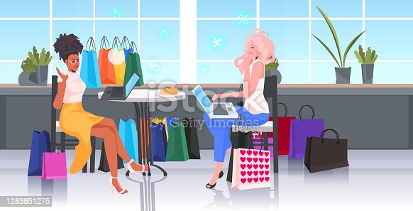 mix race women using laptop choosing and buying goods black friday shopping big sale promotion concept