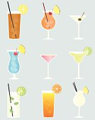 A vector illustration of nine different mixed drinks: Long Island Iced Tea, Mai Tai, Martini, Blue Hawaiian, Cosmo, Margarita, Mojito, Tequila Sunrise, and Pina Colada. Each drink is grouped on its own layer.