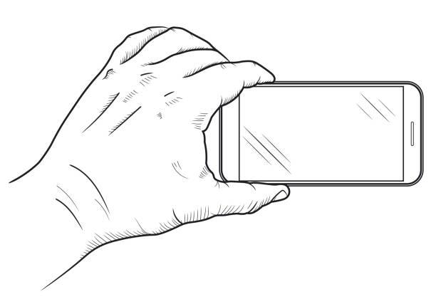 ilustrações, clipart, desenhos animados e ícones de telefone móvel na vista dianteira da mão. esboço da mão que prende o smartphone vazio. vetor - mobile