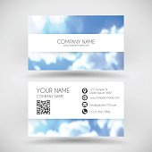 Modern business card with blurred blue sky and clouds.