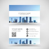 Modern business card with an view of skyscrapers. Blurred city background.