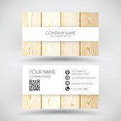 Modern business card with an wooden textured background.