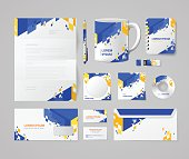 Modern corporate identity mockup template blue yellow orange abstract concept. Stationery business objects blank pen cup notebook USB flash drive CD DVD disc envelope mail card.