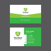 Vector modern creative and clean business card template, flat simple design with green color and shield symbol, business card vector template
