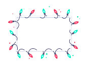 Holiday light green and red string lights frame with space for your copy.