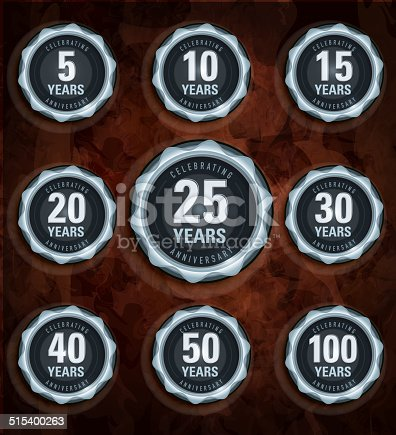 Modern set of Anniversary celebration laurels with glossy wood panel background.
