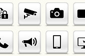 Modern technology icon set. This 100% royalty free vector illustration is featuring the square button with a drop shadow and the main icon is depicted in black. The button had a slight bevel 3D effect.