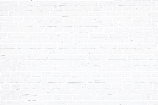 A white, light gray colored brick wall with rectangular blocks, textured grungy backgrounds. No text. No people, copy space, copyspace
