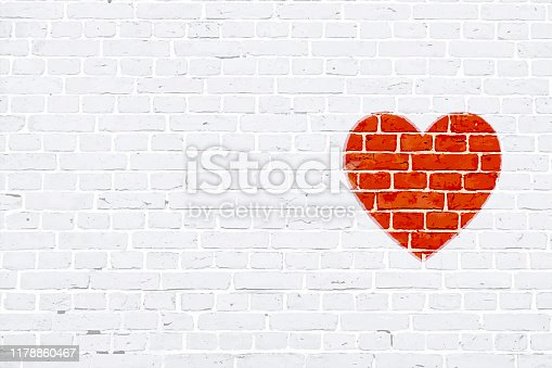 A white colored brick wall with rectangular blocks, textured grungy backgrounds. No text. No people, copy space, copyspace. Vector Xmas background. White colour vintage wall paper with one red colored heart to the right in empty grunge the frame. Simple design in red and white colors. The heart appears to be rubber stamped on wall.