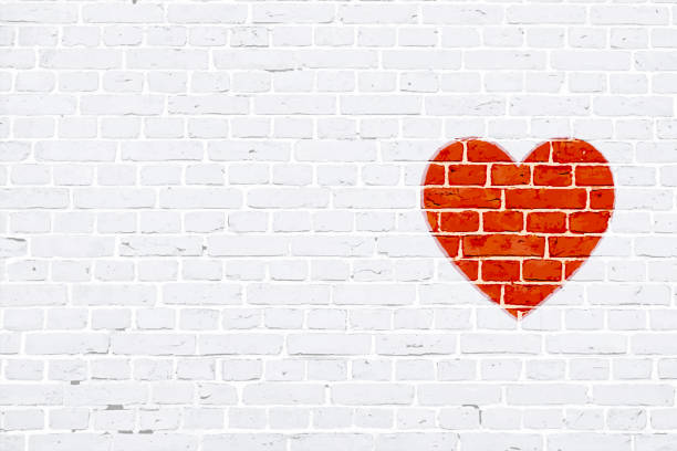 Modern white color brick pattern wall texture grunge background Xmas vector illustration with a red colored heart  graffiti graffitied or rubber stamped on wall A white colored brick wall with rectangular blocks, textured grungy backgrounds. No text. No people, copy space, copyspace. Vector Xmas background. White colour vintage wall paper with one red colored heart to the right in empty grunge the frame. Simple design in red and white colors. The heart appears to be rubber stamped on wall. romance stock illustrations