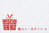 A white, light gray colored brick wall with rectangular blocks, textured grungy backgrounds. No text. No people, copy space, copyspace. Vector Xmas background. White colour vintage wall paper with a big Xmas present to the left in empty grunge the frame and followed by a line of xmas ornaments like, tree, trees, candy cane, snowflake, snowflakes, baubles, star, swirl. The gift is wrapped up and tied by ribbon tied into a bow on the top. Apt for New Year Day, New Year's eve, birthday, Xmas party gifts, presents, wallpaper, greeting card.