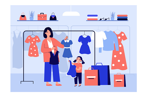 Mom choosing clothes for girl in fashion store