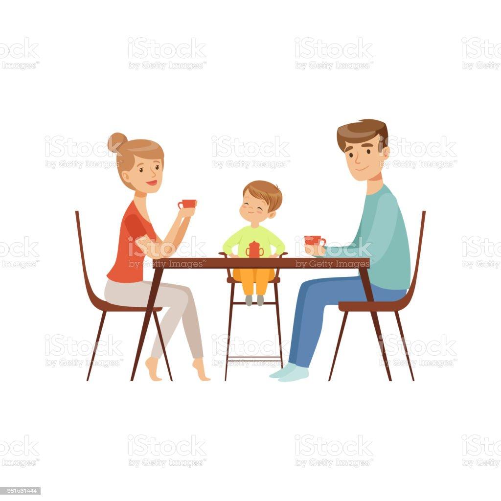 Aan De Tafel.Moeder Vader En Hun Zoon Zitten Aan De Tafel En Het Drinken Van Thee