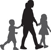 Vector silhouettes of a mother walking hand in hand with her son and daughter.