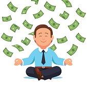 Money cash flying down on business man sitting