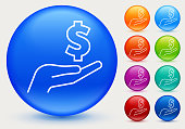 Money Dollar Sign in Hand Icon. This 100% royalty free vector illustration is featuring a blue round button with a drop shadow and the main icon is depicted in white. There are eight more color variations included on the right side of the image.