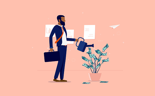 Money growth - Ethnic businessman watering a plant of dollar bills in office