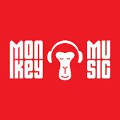 Monkey enjoys the music. Relaxing monkey in headphones. Logo for music studio with original lettering.