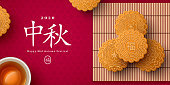 Mooncake on bamboo mat and teacup, Chinese translation is blessing and Mid Autumn. Top view of tea ceremony with cookies, China holiday poster design.
