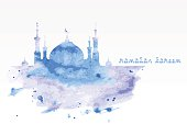Silhouette of mosque with minarets on watercolor background. Concept for Islamic Muslim holiday for celebration holy month of Ramadan Kareem. Greeting card for Ramadan Kareem