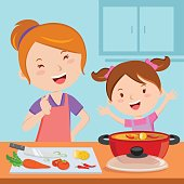 Mother and daughter cooking food