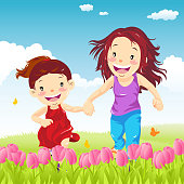 Mother and daughter holding hand running in the outdoor.