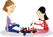 this is a mother playing chess with her daughter.