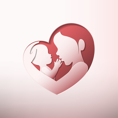 Mother holding a baby in heart shaped silhouette paper art