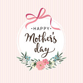 istock Mothers day greeting card, invitation with ribbon, flowers 667071380